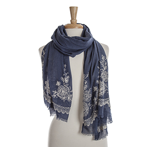 Navy blue open scarf with ivory floral embroidery details. 65% polyester and 35% viscose.