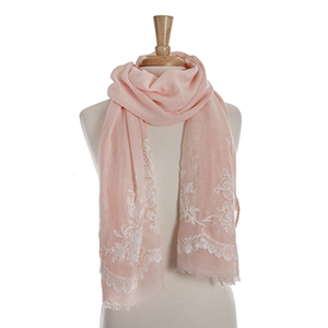Light peach open scarf with white floral embroidery details. 65% polyester and 35% viscose.