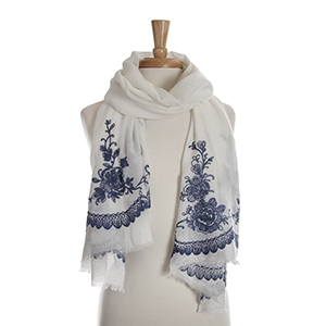 White open scarf with navy blue floral embroidery details. 65% polyester and 35% viscose.