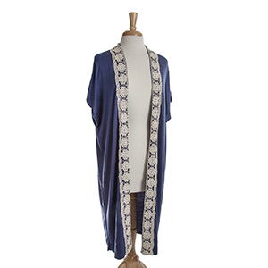 Navy blue short sleeve long cardigan with ivory crochet detailing down the front. 100% viscose. One size fits most.