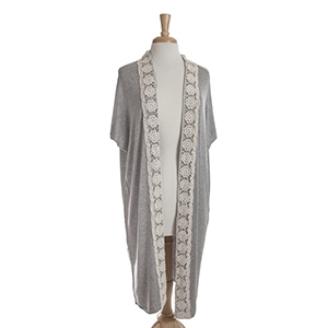 Gray short sleeve long cardigan with ivory crochet detailing down the front. 100% viscose. One size fits most.