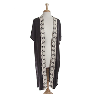 Black short sleeve long cardigan with ivory crochet detailing down the front. 100% viscose. One size fits most.