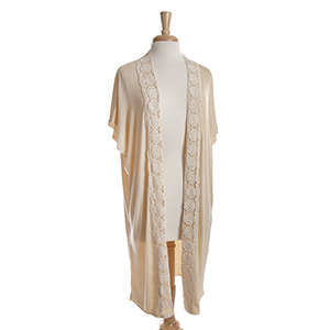 Beige short sleeve long cardigan with ivory crochet detailing down the front. 100% viscose. One size fits most.