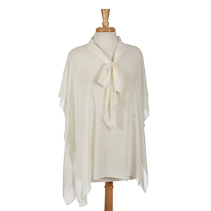 Ivory poncho top with bow front. 100% polyester. One size fits most.