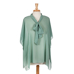 Sage green poncho top with bow front. 100% polyester. One size fits most.