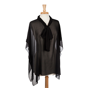Black poncho top with bow front. 100% polyester. One size fits most.