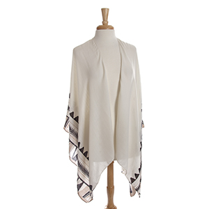 Lightweight ivory kimono/shawl with a beige and black Aztec print. 100% polyester. One size fits most.
