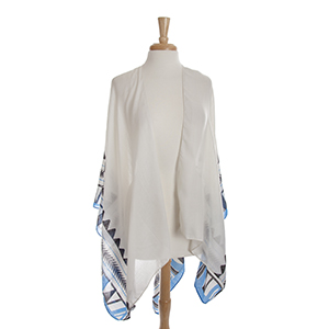 Lightweight ivory kimono/shawl with a royal blue and black Aztec print. 100% polyester. One size fits most.