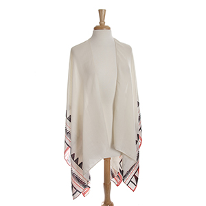 Lightweight ivory kimono/shawl with a coral and black Aztec print. 100% polyester. One size fits most.