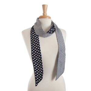 """Reversible navy blue skinny scarf with white polka dots on one side and white stripes on the other. Can also be worn as a headband. 100% polyester. Approx. 68"""" x 2.5"""""""
