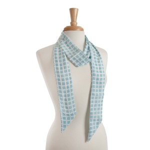 "Lightweight light blue skinny scarf with a white checker pattern that can also be worn as a headband. 100% polyester. Approx. 68"" x 2.5"""