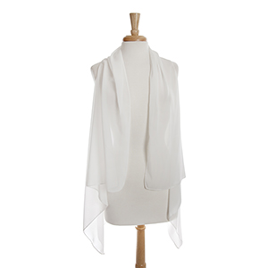 Lightweight sheer white vest. 100% polyester. One size fits most.
