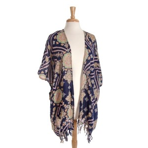 Navy blue paisley print kimono with fringe. One size fits most.