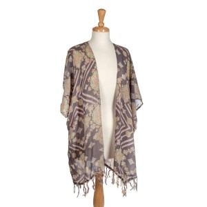 Charcoal gray paisley print kimono with fringe. One size fits most.