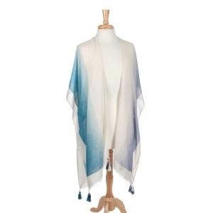 Ivory, teal, and navy blue kimono top with tassels. 100% viscose. One size fits most.