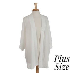White shrug perfect for layering over tops and dresses. Soft viscose fabric is light enough to wear all year around. One size fits most, plus size.