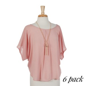 Rose pink scoop neck short sleeve top with removable gold tone tassel necklace. 100% rayon. Sold in packs of six - one small, two mediums, two larges, one extra large.