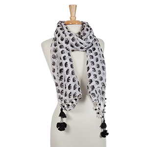 Ivory open scarf with a black elephant pattern and tassel details.
