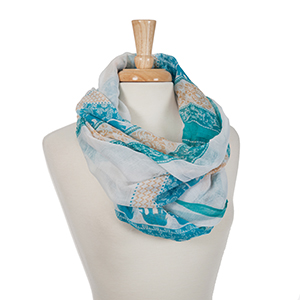 Turquoise and ivory elephant printed open scarf. 100% polyester.