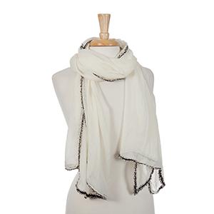 Ivory open scarf with black frayed edges. 100% viscose.