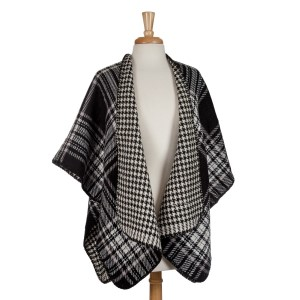 Black and white reversible kimono with houndstooth and plaid. 100% acrylic. One size fits most.