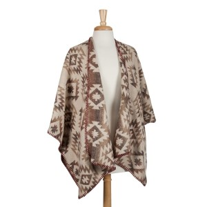 Heavyweight, beige, brown and taupe Aztec printed kimono top with beige trim. 100% acrylic. One size fits most.
