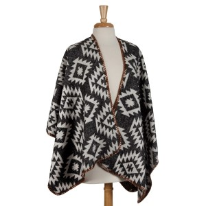 Heavyweight, ivory and gray Aztec printed kimono top with beige trim. 100% acrylic. One size fits most.