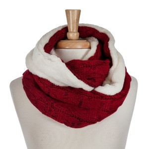 Red cable knit infinity scarf with a faux fur inside. 100% acrylic.