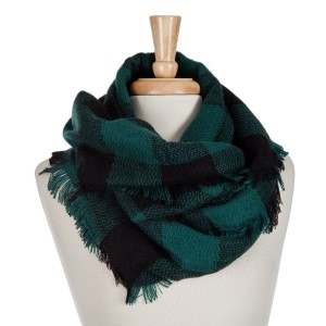 "Black and green buffalo plaid infinity scarf with frayed edges. 100% acrylic.  Measures 18"" x 36"" in size."