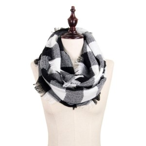 "Black and white buffalo plaid infinity scarf with frayed edges. 100% acrylic.  Measures 18"" x 36"" in size."