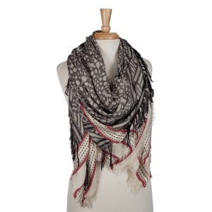 Beige and black lightweight printed blanket scarf with fringe details. 100% viscose.