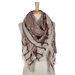 Beige and brown lightweight printed blanket scarf with fringe details. 100% viscose.