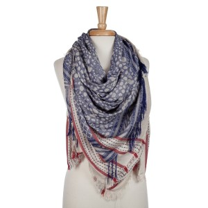 Beige and navy blue lightweight printed blanket scarf with fringe details. 100% viscose.