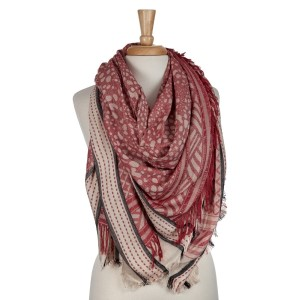 Beige and red lightweight printed blanket scarf with fringe details. 100% viscose.