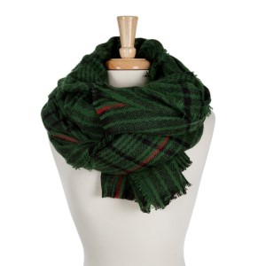 Hunter green, navy and red plaid open scarf with frayed edges. 100% acrylic.