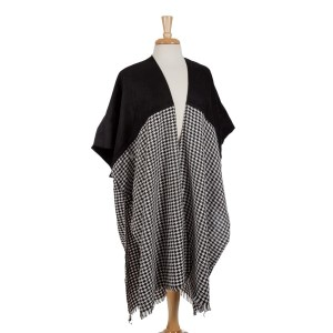 Black and houndstooth short sleeve kimono with a frayed bottom hem. 100% acrylic. One size fits most.