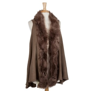 Taupe vest with a faux fur trim. 100% acrylic. One size fits most.