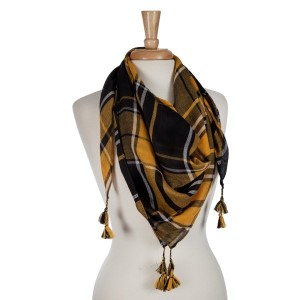 Black and gold lightweight plaid scarf with tassels. 100% polyester.