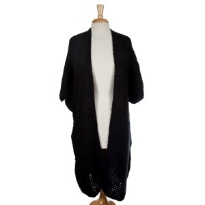 Black knit duster with short sleeves and a loose fit. 100% acrylic. One size fits most.