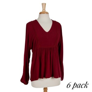 Burgundy long sleeve top with a v-neckline and a relaxed fit. 100% rayon. Sold in packs of six - two smalls, two mediums, and two larges.