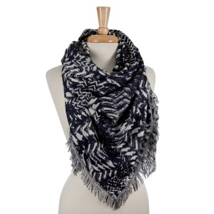 Navy blue and white patterned blanket scarf with frayed edges. 100% viscose.