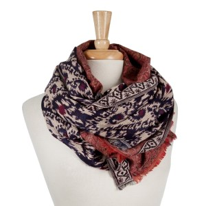 Navy blue open scarf with an Ikat and paisley pattern  and frayed edges. 100% viscose.