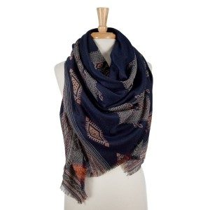 Navy blue lightweight blanket scarf with a tribal pattern and black frayed edges. 100% polyester.