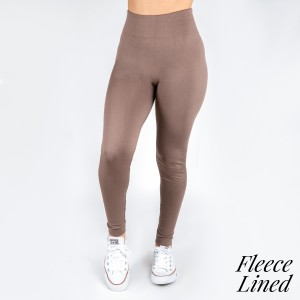 These New Mix fleece lined leggings are seamless, chic, and a must-have for every wardrobe. These cozy, full-length leggings are versatile, perfect for layering, and available in many shades. 92% Nylon 8% Spandex. One size fits most 0-14.