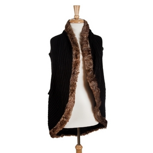 Black knit vest with a faux fur trim. 100% acrylic. One size fits most.
