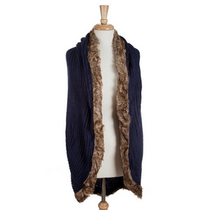 Navy blue knit vest with a faux fur trim. 100% acrylic. One size fits most.