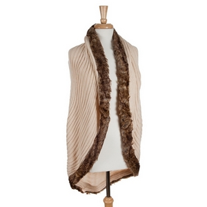 Ivory knit vest with a faux fur trim. 100% acrylic. One size fits most.