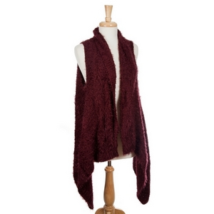 Maroon knit vest with eyelash fabric and a tapered front. 50% nylon and 50% acrylic. One size fits most.