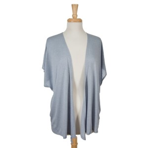 Light blue short sleeve open overlay. 65% viscose and 35% polyester. One size fits most.