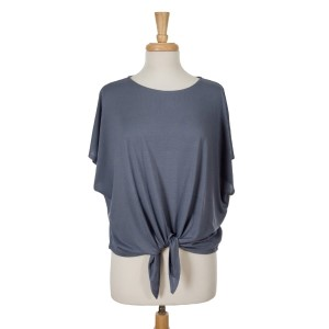 Navy blue short sleeve top with a tie front. 65% viscose and 35% polyester. One size fits most.